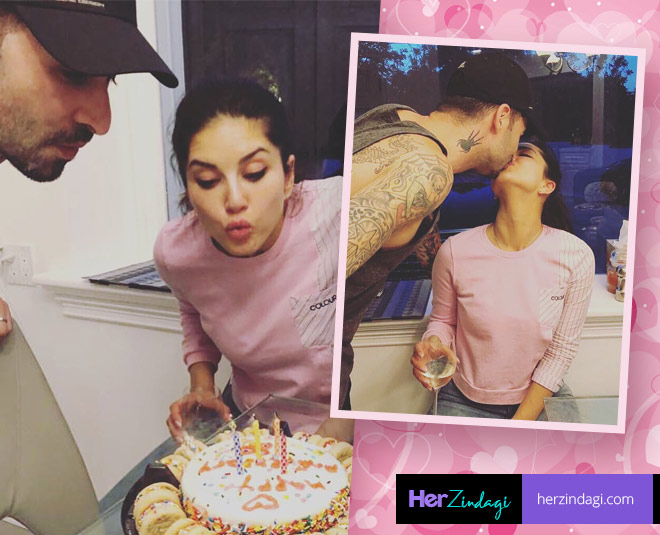 Sunny leone bollywood item dancer cut anniversary cake with her husband