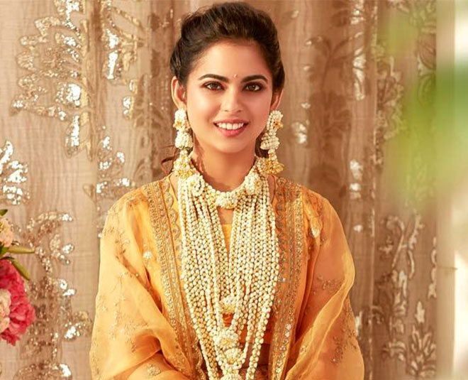 isha ambani golden makeup look