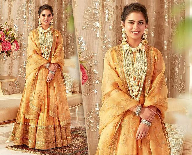 Isha ambani honey colour lehenga haldi look creates new fashion goals