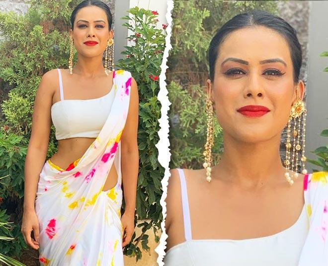 tv actress nia sharma in white saree