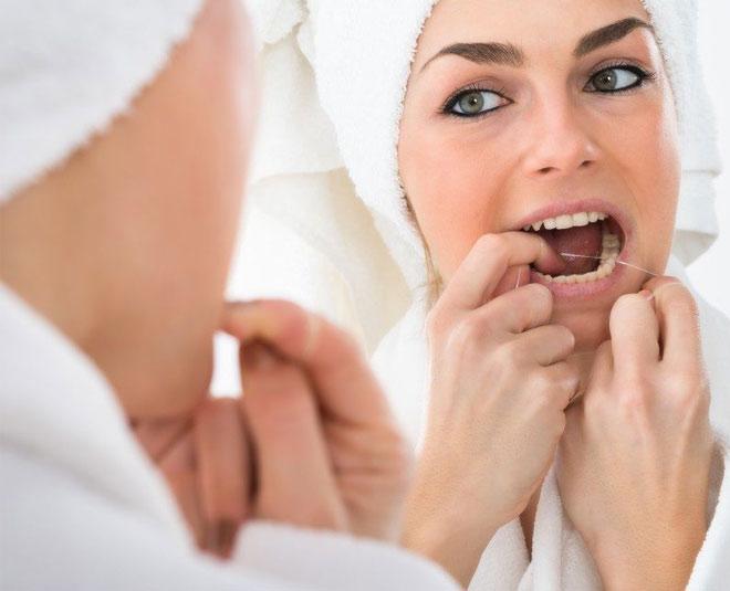 emove food stuck between teeth
