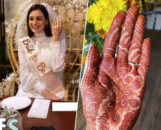 dia mirza wedding pics mehendi gown
