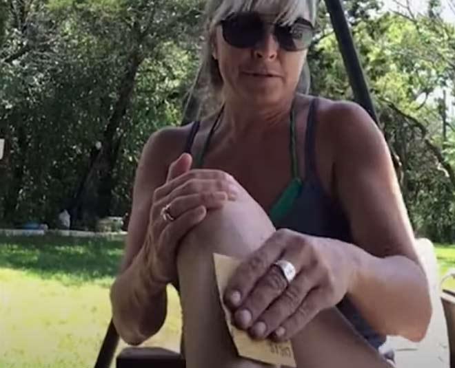 woman removes hairmain